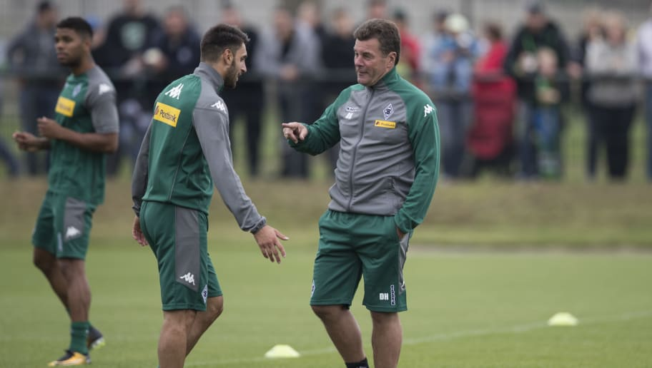 MOENCHENGLADBACH, GERMANY - JULY 02: Head Coach Dieter Hecking of Moenchengladbach (R) talks to Vincenzo Grifo during Training Session on July 2, 2017 in Moenchengladbach, Germany. (Photo by Maja Hitij/Bongarts/Getty Images )