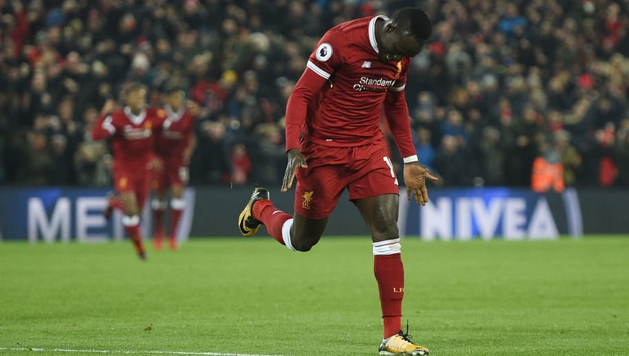 Liverpool's Senegalese midfielder Sadio Mane celebrates scoring their third goal to extend their lead 3-1 during the English Premier League football match between Liverpool and Manchester City at Anfield in Liverpool, north west England on January 14, 2018. / AFP PHOTO / Oli SCARFF / RESTRICTED TO EDITORIAL USE. No use with unauthorized audio, video, data, fixture lists, club/league logos or 'live' services. Online in-match use limited to 75 images, no video emulation. No use in betting, games or single club/league/player publications.  /         (Photo credit should read OLI SCARFF/AFP/Getty Images)
