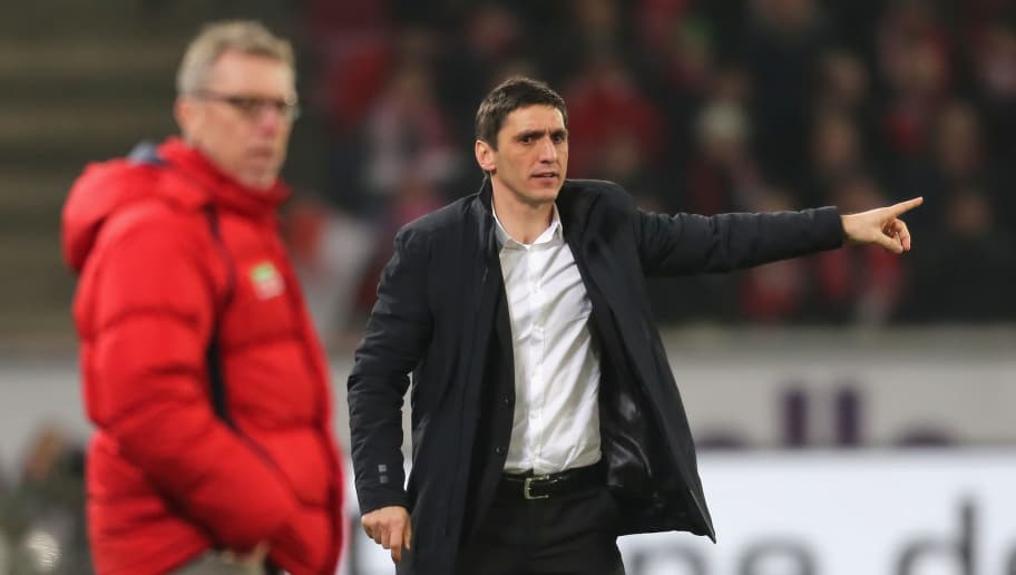 COLOGNE, GERMANY - FEBRUARY 21: Headcoach Tayfun Korkut of Hannover (R) gives instructions during the Bundesliga match between 1. FC Koeln and Hannover 96 at RheinEnergieStadion on February 21, 2015 in Cologne, Germany.  (Photo by Juergen Schwarz/Bongarts/Getty Images)