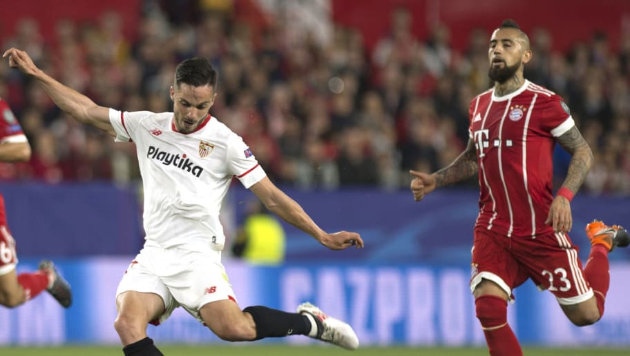 Sevilla's Spanish midfielder Pablo Sarabia (L) shoots to score a goal as Bayern Munich's Chilean midfielder Arturo Vidal approaches during the UEFA Champions League quarter-final first leg football match between Sevilla FC and Bayern Munich at the Ramon Sanchez Pizjuan Stadium in Sevilla on April 3, 2018. / AFP PHOTO / Jorge GUERRERO        (Photo credit should read JORGE GUERRERO/AFP/Getty Images)