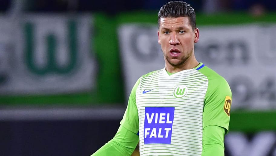 Wolfsburg's Dutch defender Jeffrey Bruma runs with the ball during the German First division Bundesliga football match VfL Wolfsburg vs Schalke 04, in Wolfsburg, on March 17, 2018. / AFP PHOTO / John MACDOUGALL / RESTRICTIONS: DURING MATCH TIME: DFL RULES TO LIMIT THE ONLINE USAGE TO 15 PICTURES PER MATCH AND FORBID IMAGE SEQUENCES TO SIMULATE VIDEO. == RESTRICTED TO EDITORIAL USE == FOR FURTHER QUERIES PLEASE CONTACT DFL DIRECTLY AT + 49 69 650050  / RESTRICTIONS: DURING MATCH TIME: DFL RULES TO LIMIT THE ONLINE USAGE TO 15 PICTURES PER MATCH AND FORBID IMAGE SEQUENCES TO SIMULATE VIDEO. == RESTRICTED TO EDITORIAL USE == FOR FURTHER QUERIES PLEASE CONTACT DFL DIRECTLY AT + 49 69 650050        (Photo credit should read JOHN MACDOUGALL/AFP/Getty Images)