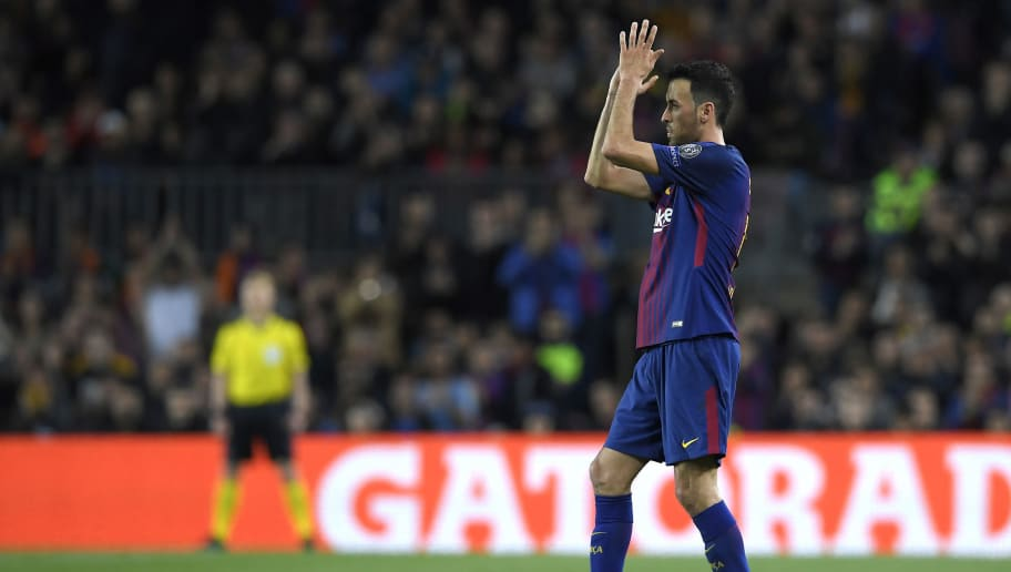 Barcelona's Spanish midfielder Sergio Busquets applauds prior to leaving the pitch during the UEFA Champions League quarter-final first leg football match between FC Barcelona and AS Roma at the Camp Nou Stadium in Barcelona on April 4, 2018. / AFP PHOTO / LLUIS GENE        (Photo credit should read LLUIS GENE/AFP/Getty Images)