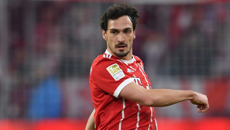 MUNICH, GERMANY - MARCH 31:  Mats Hummels of Bayern in action during the Bundesliga match between FC Bayern Muenchen and Borussia Dortmund at Allianz Arena on March 31, 2018 in Munich, Germany.  (Photo by Stuart Franklin/Bongarts/Getty Images)