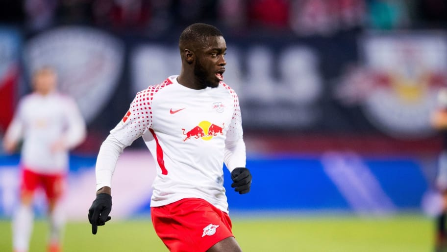Leipzig's French defender Dayot Upamecano plays the ball during the German first division Bundesliga football match between RB Leipzig and FC Bayern Munich in Leipzig, eastern Germany on March 18, 2018.  / AFP PHOTO / ROBERT MICHAEL        (Photo credit should read ROBERT MICHAEL/AFP/Getty Images)