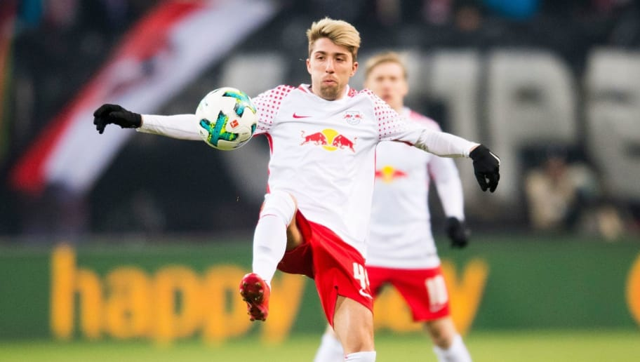 Leipzig's Slovanian midfielder Kevin Kampl plays the ball during the German first division Bundesliga football match RB Leipzig vs Borussia Dortmund in Leipzig, eastern Germany, on March 3, 2018. / AFP PHOTO / ROBERT MICHAEL / RESTRICTIONS: DURING MATCH TIME: DFL RULES TO LIMIT THE ONLINE USAGE TO 15 PICTURES PER MATCH AND FORBID IMAGE SEQUENCES TO SIMULATE VIDEO. == RESTRICTED TO EDITORIAL USE == FOR FURTHER QUERIES PLEASE CONTACT DFL DIRECTLY AT + 49 69 650050         (Photo credit should read ROBERT MICHAEL/AFP/Getty Images)