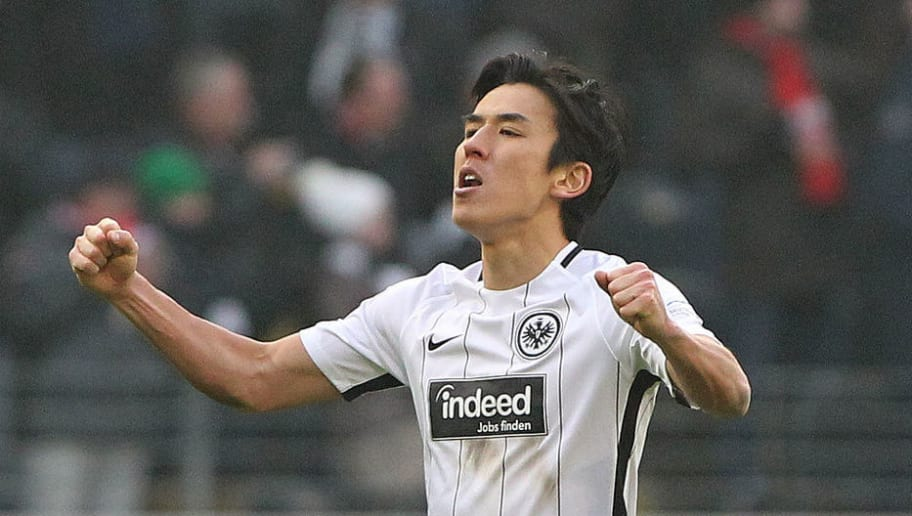 Frankfurt's Japanese midfielder Makoto Hasebe (L) and Frankfurt's German defender Marco Russ react after the German first division Bundesliga football match Eintracht Frankfurt vs Hannover 96 in Frankfurt am Main, western Germany, on March 3, 2018. / AFP PHOTO / Daniel ROLAND / RESTRICTIONS: DURING MATCH TIME: DFL RULES TO LIMIT THE ONLINE USAGE TO 15 PICTURES PER MATCH AND FORBID IMAGE SEQUENCES TO SIMULATE VIDEO. == RESTRICTED TO EDITORIAL USE == FOR FURTHER QUERIES PLEASE CONTACT DFL DIRECTLY AT + 49 69 650050         (Photo credit should read DANIEL ROLAND/AFP/Getty Images)
