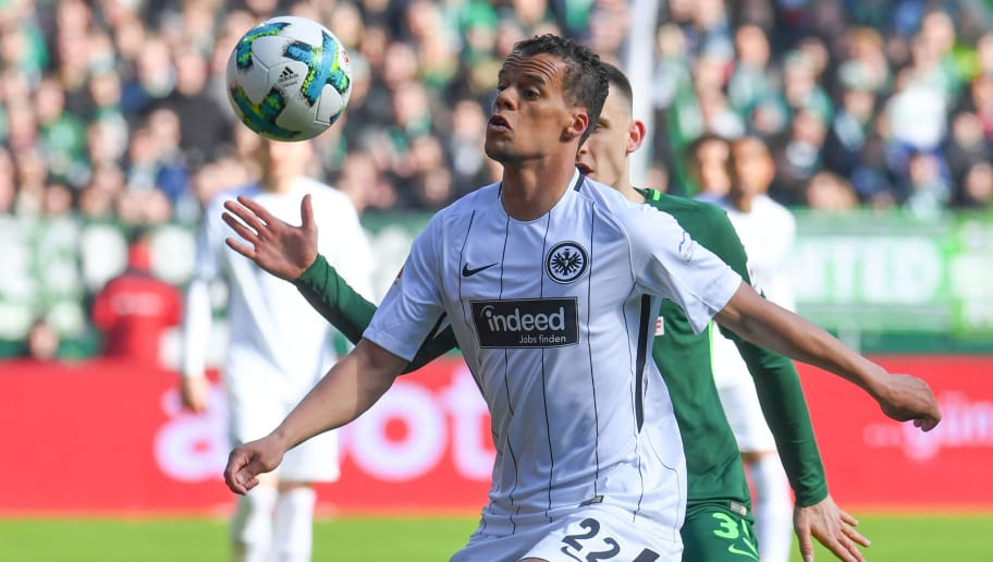 Frankfurt's US defender Timothy Chandler and Bremen's German midfielder Maximilian Eggestein vie for the ball during the German first division Bundesliga football match Werder Bremen vs Eintracht Frankfurt, in Bremen, northern Germany, on April 1, 2018. / AFP PHOTO / Patrik STOLLARZ / RESTRICTIONS: DURING MATCH TIME: DFL RULES TO LIMIT THE ONLINE USAGE TO 15 PICTURES PER MATCH AND FORBID IMAGE SEQUENCES TO SIMULATE VIDEO. == RESTRICTED TO EDITORIAL USE == FOR FURTHER QUERIES PLEASE CONTACT DFL DIRECTLY AT + 49 69 650050         (Photo credit should read PATRIK STOLLARZ/AFP/Getty Images)