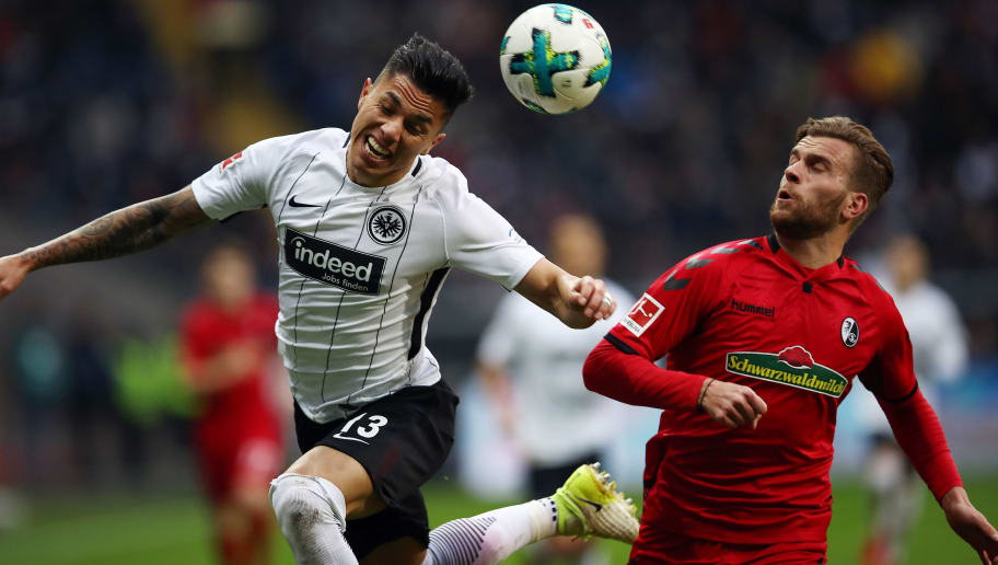 FRANKFURT AM MAIN, GERMANY - JANUARY 13: Lucas Hoeler of Freiburg (r) fights for the ball with Carlos Salcedo of Frankfurt during the Bundesliga match between Eintracht Frankfurt and Sport-Club Freiburg at Commerzbank-Arena on January 13, 2018 in Frankfurt am Main, Germany. (Photo by Maja Hitij/Bongarts/Getty Images)