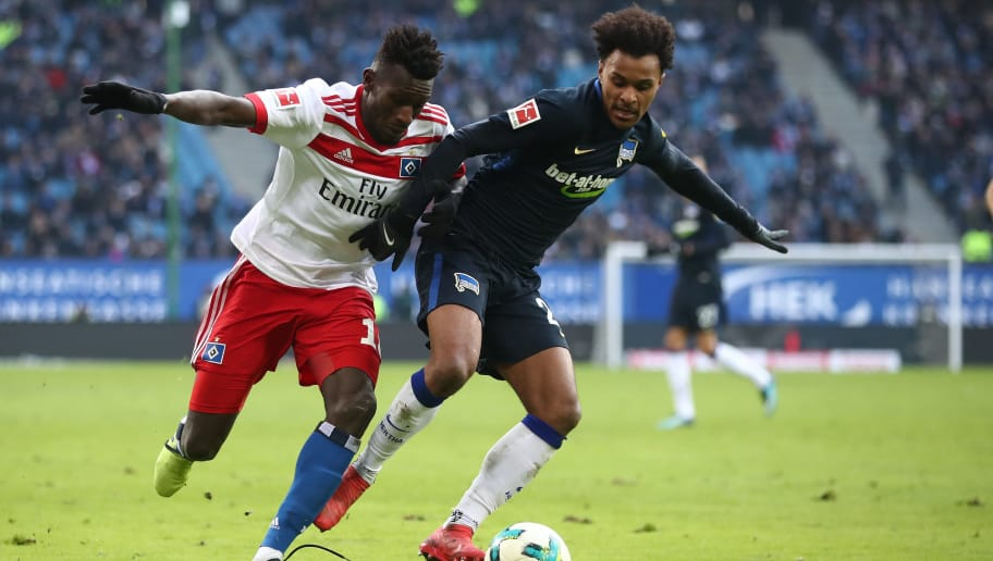HAMBURG, GERMANY - MARCH 17: Bakery Jatta (L) of Hamburg and Valentino Lazaro (R) of Berlin compete for the ball during the Bundesliga match between Hamburger SV and Hertha BSC at Volksparkstadion on March 17, 2018 in Hamburg, Germany.  (Photo by Oliver Hardt/Bongarts/Getty Images)