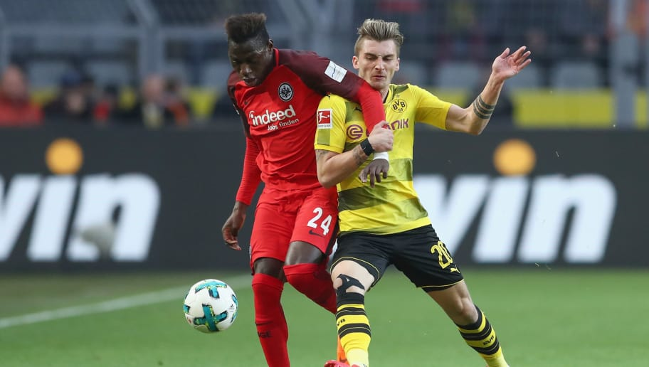 DORTMUND, GERMANY - MARCH 11:  Danny da Costa (L) of Frankfurt is challenged by Maximilian Philipp of Dortmund during the Bundesliga match between Borussia Dortmund and Eintracht Frankfurt at Signal Iduna Park on March 11, 2018 in Dortmund, Germany.  (Photo by Lars Baron/Bongarts/Getty Images)
