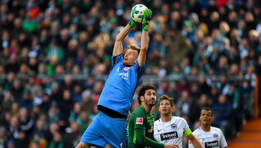 Frankfurt's Finnish goalkeeper Lukas Hradecky and Bremen's Algerian forward Ishak Belfodil vie for the ball during the German first division Bundesliga football match Werder Bremen vs Eintracht Frankfurt, in Bremen, northern Germany, on April 1, 2018. / AFP PHOTO / Patrik STOLLARZ / RESTRICTIONS: DURING MATCH TIME: DFL RULES TO LIMIT THE ONLINE USAGE TO 15 PICTURES PER MATCH AND FORBID IMAGE SEQUENCES TO SIMULATE VIDEO. == RESTRICTED TO EDITORIAL USE == FOR FURTHER QUERIES PLEASE CONTACT DFL DIRECTLY AT + 49 69 650050         (Photo credit should read PATRIK STOLLARZ/AFP/Getty Images)