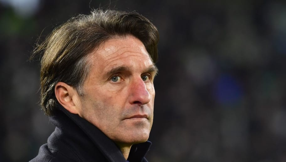 Wolfsburg's German headcoach Bruno Labbadia looks over a warm-up session ahead the German First division Bundesliga football match VfL Wolfsburg vs Schalke 04, in Wolfsburg, on March 17, 2018. / AFP PHOTO / John MACDOUGALL / RESTRICTIONS: DURING MATCH TIME: DFL RULES TO LIMIT THE ONLINE USAGE TO 15 PICTURES PER MATCH AND FORBID IMAGE SEQUENCES TO SIMULATE VIDEO. == RESTRICTED TO EDITORIAL USE == FOR FURTHER QUERIES PLEASE CONTACT DFL DIRECTLY AT + 49 69 650050  / RESTRICTIONS: DURING MATCH TIME: DFL RULES TO LIMIT THE ONLINE USAGE TO 15 PICTURES PER MATCH AND FORBID IMAGE SEQUENCES TO SIMULATE VIDEO. == RESTRICTED TO EDITORIAL USE == FOR FURTHER QUERIES PLEASE CONTACT DFL DIRECTLY AT + 49 69 650050        (Photo credit should read JOHN MACDOUGALL/AFP/Getty Images)