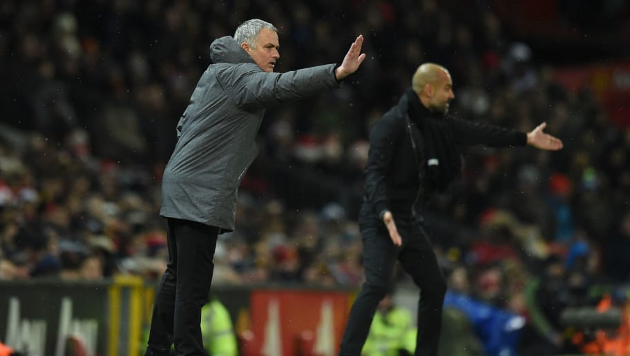 Manchester United's Portuguese manager Jose Mourinho (L) and Manchester City's Spanish manager Pep Guardiola (R) gestures from the touchline during the English Premier League football match between Manchester United and Manchester City at Old Trafford in Manchester, north west England, on December 10, 2017. / AFP PHOTO / Oli SCARFF / RESTRICTED TO EDITORIAL USE. No use with unauthorized audio, video, data, fixture lists, club/league logos or 'live' services. Online in-match use limited to 75 images, no video emulation. No use in betting, games or single club/league/player publications.  /         (Photo credit should read OLI SCARFF/AFP/Getty Images)