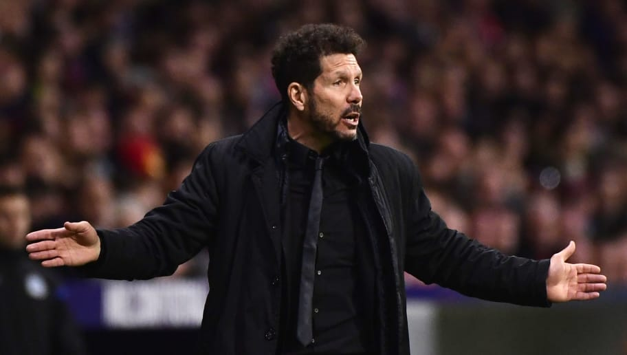 Atletico Madrid's Argentinian coach Diego Simeone gestures during the Spanish League football match between Atletico Club Atletico de Madrid and RC Deportivo de La Coruna at the Wanda Metropolitano stadium on April 1, 2018. / AFP PHOTO / PIERRE-PHILIPPE MARCOU        (Photo credit should read PIERRE-PHILIPPE MARCOU/AFP/Getty Images)