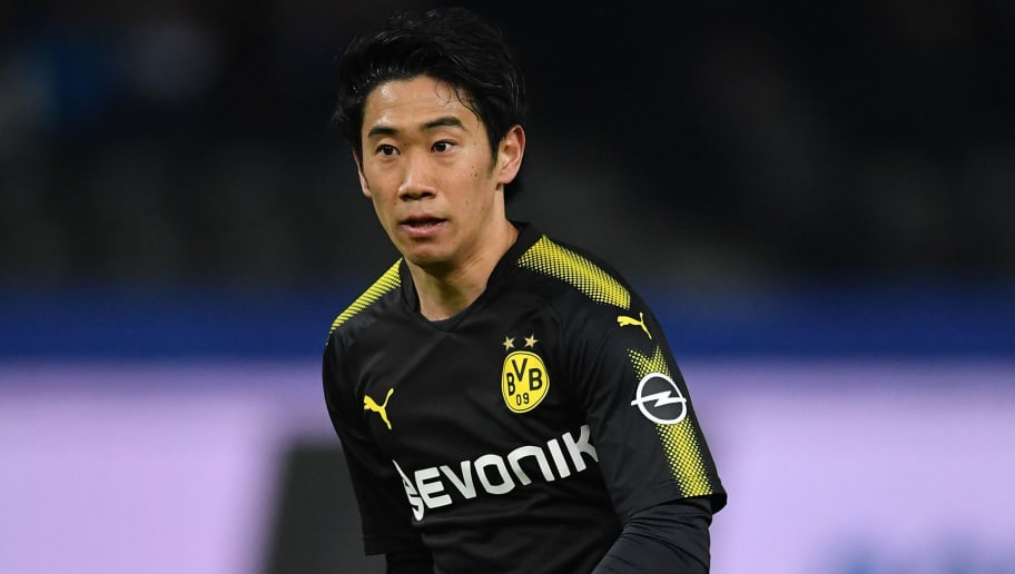 BERLIN, GERMANY - JANUARY 19:  Shinji Kagawa of Dortmund in action during the Bundesliga match between Hertha BSC and Borussia Dortmund at Olympiastadion on January 19, 2018 in Berlin, Germany.  (Photo by Stuart Franklin/Bongarts/Getty Images)
