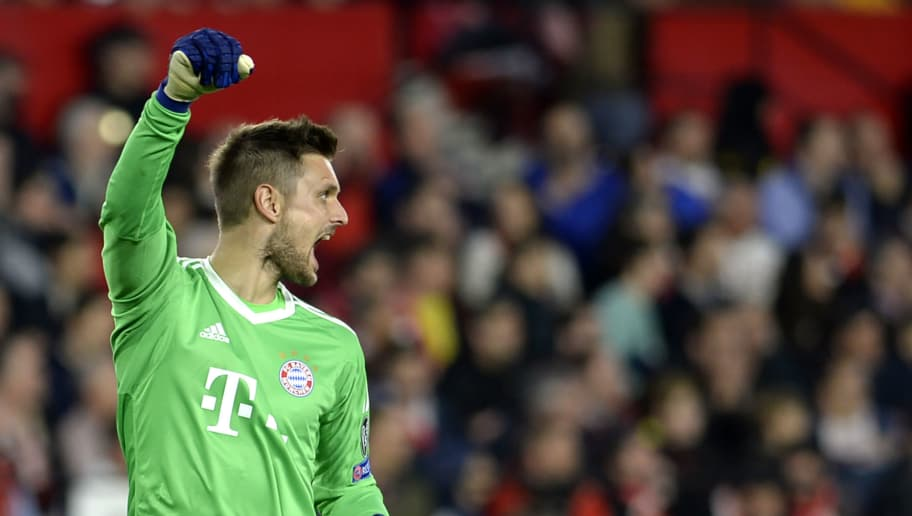Bayern Munich's German goalkeeper Sven Ulreich celebrates his team's second goal during the UEFA Champions League quarter-final first leg football match between Sevilla FC and Bayern Munich at the Ramon Sanchez Pizjuan Stadium in Sevilla on April 3, 2018. / AFP PHOTO / CRISTINA QUICLER        (Photo credit should read CRISTINA QUICLER/AFP/Getty Images)