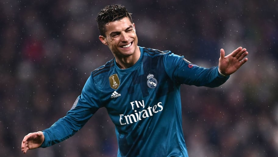 Real Madrid's Portuguese forward Cristiano Ronaldo celebrates after scoring a second goal during the UEFA Champions League quarter-final first leg football match between Juventus and Real Madrid at the Allianz Stadium in Turin on April 3, 2018. / AFP PHOTO / Marco BERTORELLO        (Photo credit should read MARCO BERTORELLO/AFP/Getty Images)