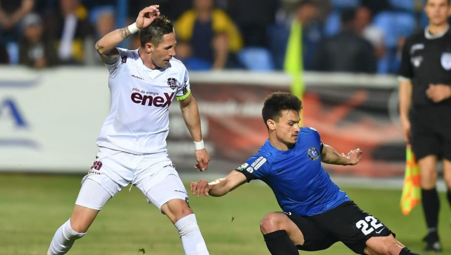 Cristian George Ganea (R) of Viitorul Constanta and Ciprian Ioan Deac (L) of CFR Cluj vie for the ball during the play-off match of the Romanian first league football Championship between Viitorul Constanta and CFR Cluj in Constanta, southeastern Romania, on May 13, 2017. / AFP PHOTO / DANIEL MIHAILESCU        (Photo credit should read DANIEL MIHAILESCU/AFP/Getty Images)