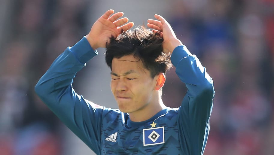 STUTTGART, GERMANY - MARCH 31: Tatsuya Ito of Hamburg looks dejected after missing a chance during the Bundesliga match between VfB Stuttgart and Hamburger SV at Mercedes-Benz Arena on March 31, 2018 in Stuttgart, Germany. (Photo by Simon Hofmann/Bongarts/Getty Images)