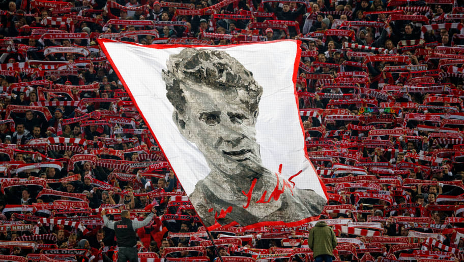 COLOGNE, GERMANY - NOVEMBER 26:  Fans of Koeln wave a flag with a picture of Hans Schaefer prior to the Bundesliga match between 1. FC Koeln and Hertha BSC at RheinEnergieStadion on November 26, 2017 in Cologne, Germany.  (Photo by Lars Baron/Bongarts/Getty Images)