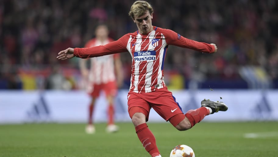 Atletico Madrid's French forward Antoine Griezmann shoots the ball during the UEFA Europa League quarter-final first leg football match between Club Atletico de Madrid and Sporting CP at the Wanda Metropolitano Stadium in Madrid on April 5, 2018. / AFP PHOTO / GABRIEL BOUYS        (Photo credit should read GABRIEL BOUYS/AFP/Getty Images)