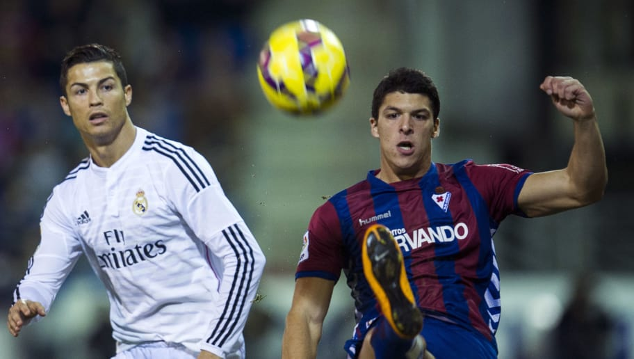 EIBAR, SPAIN - NOVEMBER 22: Cristiano Ronaldo of Real Madrid duels for the ball with Ander Capa  of SD Eibar during the La Liga match between SD Eibar and Real Madrid at Ipurua Municipal Stadium on November 22, 2014 in Eibar, Spain.  (Photo by Juan Manuel Serrano Arce/Getty Images)
