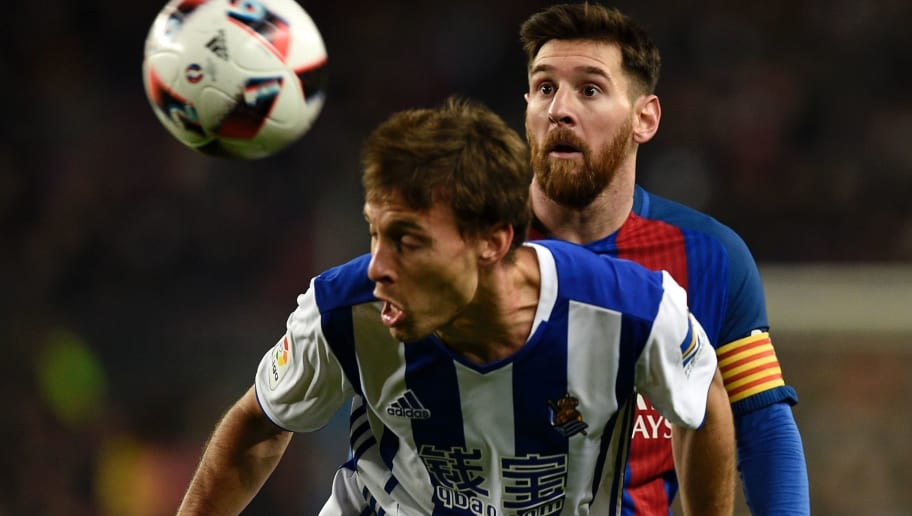 Barcelona's Argentinian forward Lionel Messi (R) vies with Real Sociedad's midfielder Sergio Canales during the Spanish Copa del Rey (King's Cup) quarter final second leg football match FC Barcelona vs Real Sociedad at the Camp Nou stadium in Barcelona on January 26, 2017. / AFP / LLUIS GENE        (Photo credit should read LLUIS GENE/AFP/Getty Images)