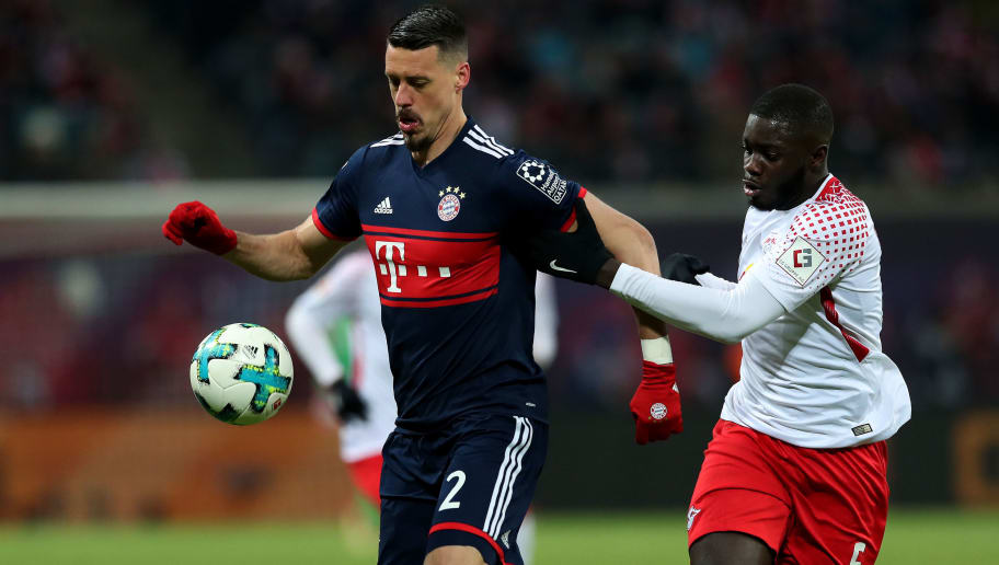 LEIPZIG, GERMANY - MARCH 18: Sandro Wagner (L) of FC Bayern Muenchen vies with Dayot Upamecano (R) of RB Leipzig during the Bundesliga match between RB Leipzig and FC Bayern Muenchen at Red Bull Arena on March 18, 2018 in Leipzig, Germany. (Photo by Ronny Hartmann/Bongarts/Getty Images)