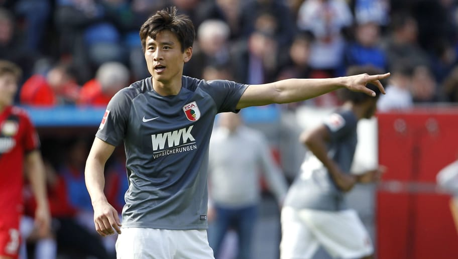 LEVERKUSEN, GERMANY - MARCH 31: Ja-Cheol Koo of Augsburg reacts during the Bundesliga match between Bayer 04 Leverkusen and FC Augsburg at BayArena on March 31, 2018 in Leverkusen, Germany. (Photo by Mika Volkmann/Bongarts/Getty Images)