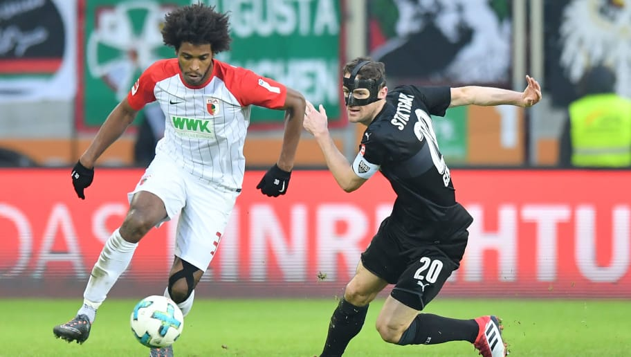 AUGSBURG, GERMANY - FEBRUARY 18: Francisco da Silva Caiuby of Augsburg and Christian Gentner of Stuttgart compete for the ball during the Bundesliga match between FC Augsburg and VfB Stuttgart at WWK-Arena on February 18, 2018 in Augsburg, Germany. (Photo by Sebastian Widmann/Bongarts/Getty Images)