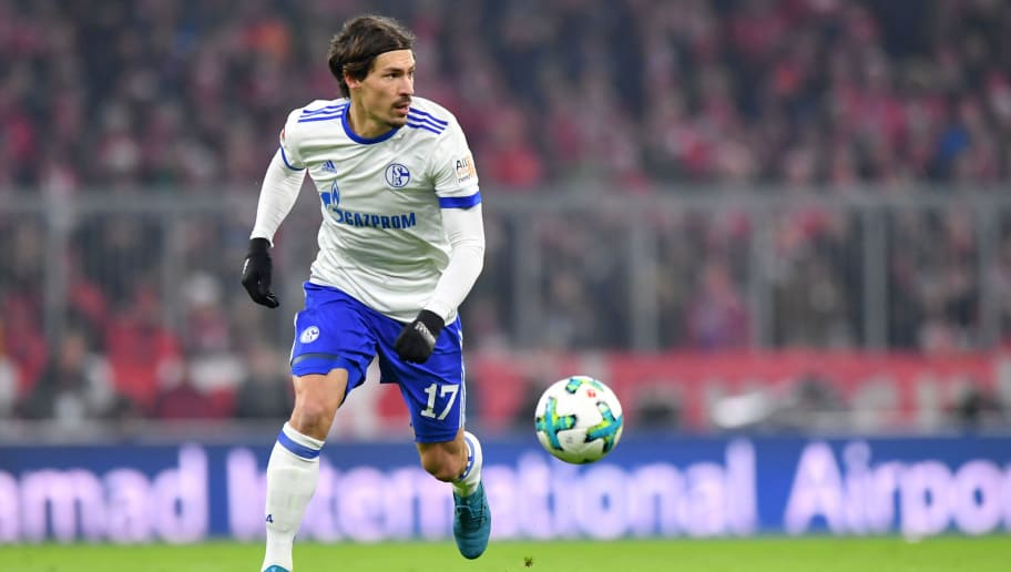 MUNICH, GERMANY - FEBRUARY 10: Benjamin Stambouli of Schalke plays the ball during the Bundesliga match between FC Bayern Muenchen and FC Schalke 04 at Allianz Arena on February 10, 2018 in Munich, Germany. (Photo by Sebastian Widmann/Bongarts/Getty Images)