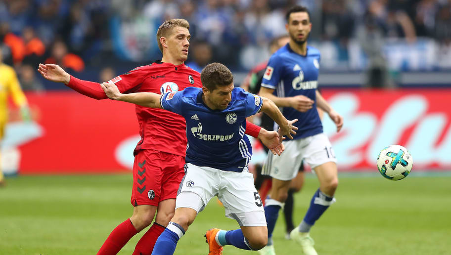 GELSENKIRCHEN, GERMANY - MARCH 31: Nils Petersen of Freiburg (l) fights for the bad with Matija Nastasic of Schalke during the Bundesliga match between FC Schalke 04 and Sport-Club Freiburg at Veltins-Arena on March 31, 2018 in Gelsenkirchen, Germany. (Photo by Martin Rose/Bongarts/Getty Images)
