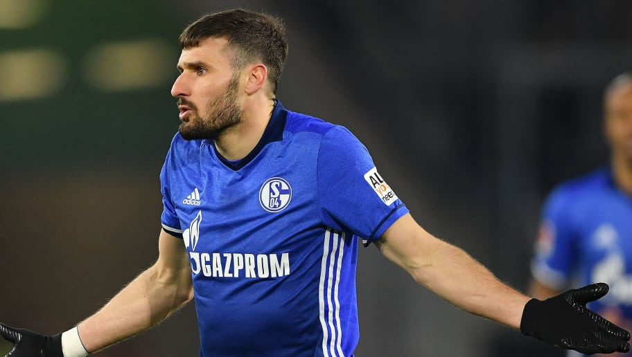WOLFSBURG, GERMANY - MARCH 17: Daniel Caligiuri of Schalke reacts during the Bundesliga match between VfL Wolfsburg and FC Schalke 04 at Volkswagen Arena on March 17, 2018 in Wolfsburg, Germany. (Photo by Stuart Franklin/Bongarts/Getty Images)