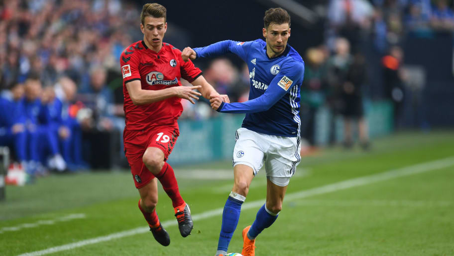 Schalke's German midfielder Leon Goretzka and Freiburg's German forward Janik Haberer vie for the ball during the German first division Bundesliga football match FC Schalke 04 vs SC Freiburg, in Gelsenkirchen, western Germany, on March 31, 2018. / AFP PHOTO / Patrik STOLLARZ / RESTRICTIONS: DURING MATCH TIME: DFL RULES TO LIMIT THE ONLINE USAGE TO 15 PICTURES PER MATCH AND FORBID IMAGE SEQUENCES TO SIMULATE VIDEO. == RESTRICTED TO EDITORIAL USE == FOR FURTHER QUERIES PLEASE CONTACT DFL DIRECTLY AT + 49 69 650050         (Photo credit should read PATRIK STOLLARZ/AFP/Getty Images)