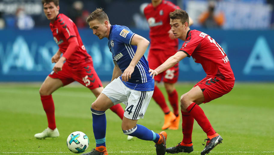 GELSENKIRCHEN, GERMANY - MARCH 31: Bastian Oczipka of Schalke (l) is chased by Pascal Stenzel of Freiburg during the Bundesliga match between FC Schalke 04 and Sport-Club Freiburg at Veltins-Arena on March 31, 2018 in Gelsenkirchen, Germany. (Photo by Martin Rose/Bongarts/Getty Images)