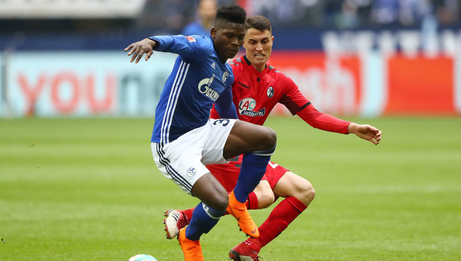 GELSENKIRCHEN, GERMANY - MARCH 31: Breel Embolo of Schalke (l) fits for the ball with Nicolas Hoefler of Freiburg during the Bundesliga match between FC Schalke 04 and Sport-Club Freiburg at Veltins-Arena on March 31, 2018 in Gelsenkirchen, Germany. (Photo by Martin Rose/Bongarts/Getty Images)