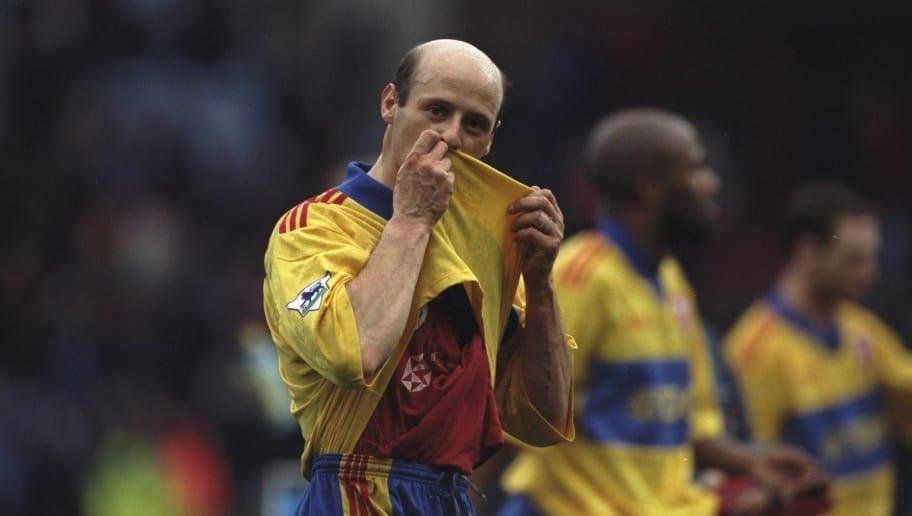 14 Mar 1998:  Crystal Palace Coach Attilio Lombardo kisses his shirt during an FA Carling Premiership match against Aston Villa at Villa Park in Birmingham, England. Aston Villa won the match 3-1. \ Mandatory Credit: Ross  Kinnaird/Allsport