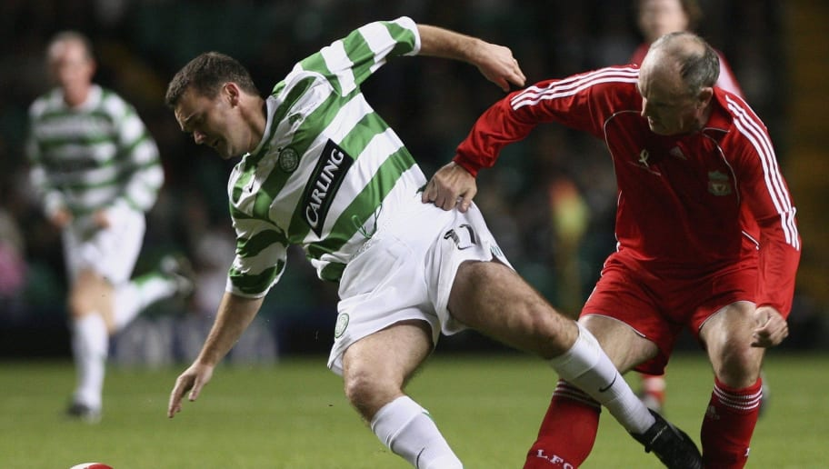GLASGOW, UNITED KINGDOM - OCTOBER 04: Andy Walker of Celtic Legends challenges John Wark of Liverpool Legends during the charity chalenge match at Celtic Park on October 4, 2006 in Glasgow, Scotland.  (Photo by Jeff J Mitchell/Getty Images)