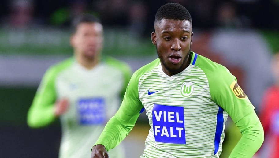Wolfsburg's Dutch midfielder Riechedly Bazoer runs with the ball during the German First division Bundesliga football match VfL Wolfsburg vs Schalke 04, in Wolfsburg, on March 17, 2018. / AFP PHOTO / John MACDOUGALL / RESTRICTIONS: DURING MATCH TIME: DFL RULES TO LIMIT THE ONLINE USAGE TO 15 PICTURES PER MATCH AND FORBID IMAGE SEQUENCES TO SIMULATE VIDEO. == RESTRICTED TO EDITORIAL USE == FOR FURTHER QUERIES PLEASE CONTACT DFL DIRECTLY AT + 49 69 650050  / RESTRICTIONS: DURING MATCH TIME: DFL RULES TO LIMIT THE ONLINE USAGE TO 15 PICTURES PER MATCH AND FORBID IMAGE SEQUENCES TO SIMULATE VIDEO. == RESTRICTED TO EDITORIAL USE == FOR FURTHER QUERIES PLEASE CONTACT DFL DIRECTLY AT + 49 69 650050        (Photo credit should read JOHN MACDOUGALL/AFP/Getty Images)