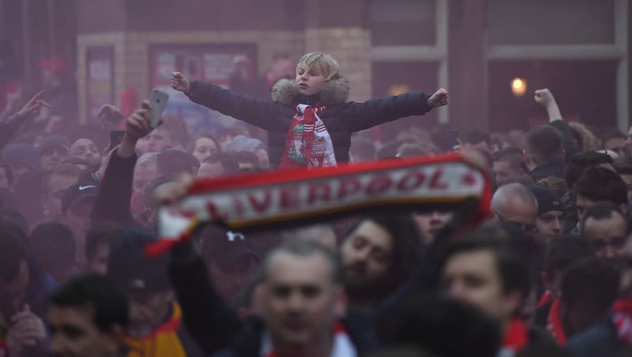 LIVERPOOL, ENGLAND - APRIL 04:  A Liverpool fan enjoys the pre match atmosphere as the team bus arrives prior to the UEFA Champions League Quarter Final Leg One match between Liverpool and Manchester City at Anfield on April 4, 2018 in Liverpool, England.  (Photo by Shaun Botterill/Getty Images)