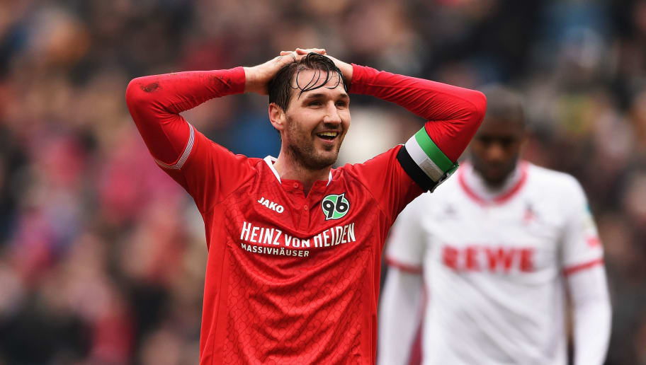 HANOVER, GERMANY - MARCH 12:  Christian Schulz of Hannover reacts during the Bundesliga match between Hannover 96 and 1. FC Koeln at HDI-Arena on March 12, 2016 in Hanover, Germany.  (Photo by Stuart Franklin/Bongarts/Getty Images)