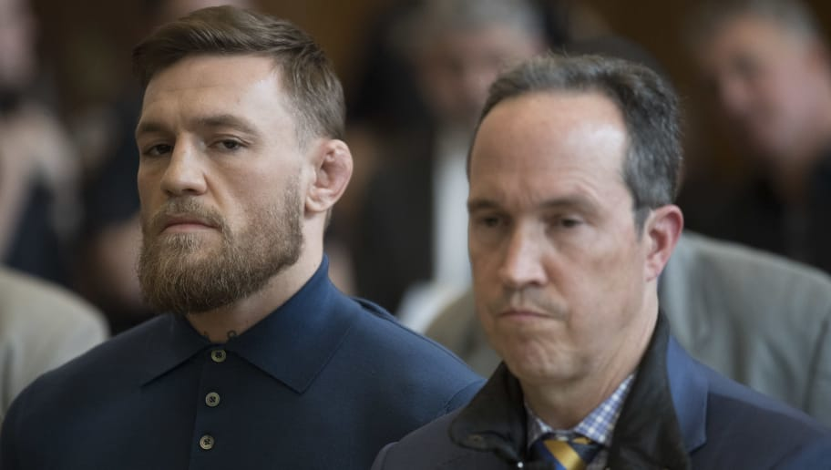 NEW YORK, NY - APRIL 06: Ultimate fighting star Conor McGregor stands with his lawyer Jim Walden during an arraignment in Brooklyn Criminal court on April 6, 2018 in New York City. McGregor is facing criminal charges in the wake of a backstage melee he allegedly instigated that has forced the removal of three fighters from UFC's biggest card of the year. Video footage appears to show the promotion's most bankable star throwing a hand truck at a bus full of fighters after a Thursday news conference for UFC 223 at Brooklyn's Barclays Center. (Photo by Mary Altaffer-Pool/Getty Images)