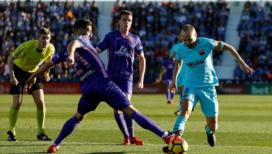 Barcelona's Spanish midfielder Andres Iniesta (R) challenges Leganes' Spanish midfielder Ruben Perez during the Spanish league football match Leganes vs Barcelona at the Butarque stadium in Leganes on November 18, 2017. / AFP PHOTO / OSCAR DEL POZO        (Photo credit should read OSCAR DEL POZO/AFP/Getty Images)