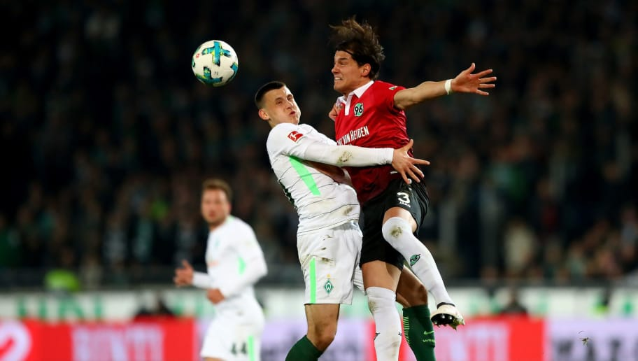 HANOVER, GERMANY - APRIL 06:  Inola Albornoz (R) of Hannover and Maximilian Eggestein of Bremen battle for the ball during the Bundesliga match between Hannover 96 and SV Werder Bremen at HDI-Arena on April 6, 2018 in Hanover, Germany.  (Photo by Martin Rose/Bongarts/Getty Images)