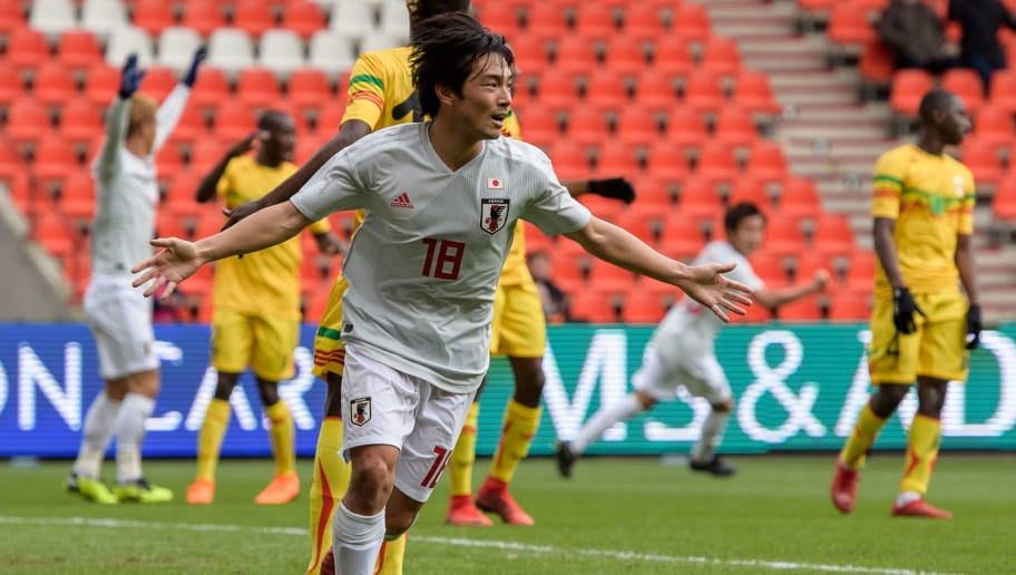 LIEGE, BELGIUM - MARCH 23: Shoya Nakajima of Japan reacts after his goal for the 1-1 during an international friendly between Japan and Mali at the Stade de Sclessin on March 23, 2018 in Liege, Belgium. (Photo by Jörg Schüler/Getty Images)