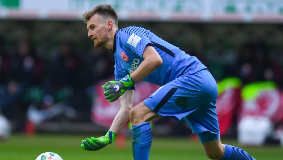 Frankfurt's Finnish goalkeeper Lukas Hradecky plays the ball during the German first division Bundesliga football match Werder Bremen vs Eintracht Frankfurt, in Bremen, northern Germany, on April 1, 2018. / AFP PHOTO / Patrik STOLLARZ / RESTRICTIONS: DURING MATCH TIME: DFL RULES TO LIMIT THE ONLINE USAGE TO 15 PICTURES PER MATCH AND FORBID IMAGE SEQUENCES TO SIMULATE VIDEO. == RESTRICTED TO EDITORIAL USE == FOR FURTHER QUERIES PLEASE CONTACT DFL DIRECTLY AT + 49 69 650050         (Photo credit should read PATRIK STOLLARZ/AFP/Getty Images)