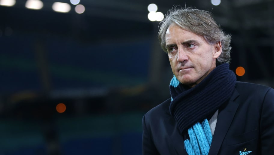 LEIPZIG, GERMANY - MARCH 08:  Head coach Roberto Mancini of FC Zenit Saint Petersburg enters the pitch prior to the UEFA Europa League Round of 16 match between RB Leipzig and Zenit St Petersburg at the Red Bull Arena on March 8, 2018 in Leipzig, Germany. (Photo by Ronny Hartmann/Bongarts/Getty Images)