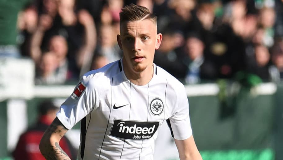 Frankfurt's German midfielder Marius Wolf plays the ball during the German first division Bundesliga football match Werder Bremen vs Eintracht Frankfurt, in Bremen, northern Germany, on April 1, 2018. / AFP PHOTO / Patrik STOLLARZ / RESTRICTIONS: DURING MATCH TIME: DFL RULES TO LIMIT THE ONLINE USAGE TO 15 PICTURES PER MATCH AND FORBID IMAGE SEQUENCES TO SIMULATE VIDEO. == RESTRICTED TO EDITORIAL USE == FOR FURTHER QUERIES PLEASE CONTACT DFL DIRECTLY AT + 49 69 650050         (Photo credit should read PATRIK STOLLARZ/AFP/Getty Images)