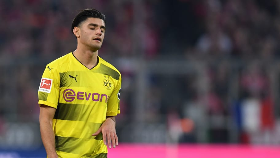 Dortmund's midfielder Mahmoud Dahoud reacts during the German first division Bundesliga football match FC Bayern Munich vs Borussia Dortmund in Munich, southern Germany, on March 31, 2018.  / AFP PHOTO / Christof STACHE / RESTRICTIONS: DURING MATCH TIME: DFL RULES TO LIMIT THE ONLINE USAGE TO 15 PICTURES PER MATCH AND FORBID IMAGE SEQUENCES TO SIMULATE VIDEO. == RESTRICTED TO EDITORIAL USE == FOR FURTHER QUERIES PLEASE CONTACT DFL DIRECTLY AT + 49 69 650050         (Photo credit should read CHRISTOF STACHE/AFP/Getty Images)