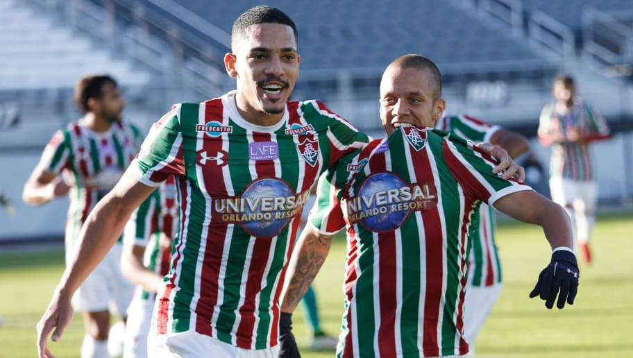 Marcos Junior of  Brazilian club Fluminense (R) celebrates with teammate Gilberto after scoring a goal in the first half against Barcelona SC of Ecuador during their Florida Cup soccer game at Spectrum Stadium in Orlando, Florida on January 15, 2018.  / AFP PHOTO / Gregg Newton        (Photo credit should read GREGG NEWTON/AFP/Getty Images)